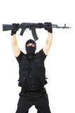 Watch out!. Portrait of armed assassin raising rifle in his hands over white background Stock Photo