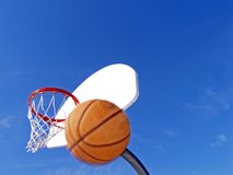 Watch Out. Basketball in motion on the way down Royalty Free Stock Image