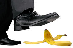 Watch out. Businessman about to step on banana peel Royalty Free Stock Photo