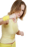 Watch out!. Sportive agressive blond girl in yellow fitness outfits training tae-bo Stock Photos