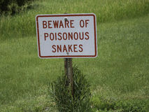 Watch Out for Snakes. A sign cautioning walkers of the presence of poisonous snakes, in this case rattlesnakes, near the Missouri River Royalty Free Stock Images