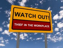 Watch out, thief. In the workplace written on yellow traffic sign against blue sky with clouds royalty free stock photos