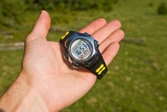 Watch on a palm Royalty Free Stock Photography