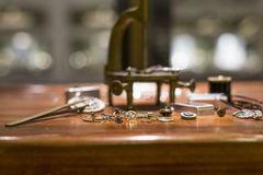 Watch Parts. Pieces of watch parts on top of wooden table stock photos