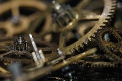 Collection of Vintage Metallic Watch Gears on a Black Surface Stock Photography