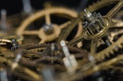 Collection of Vintage Metallic Watch Gears on a Black Surface Royalty Free Stock Photos