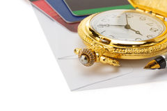 Watch and pen at envelope Royalty Free Stock Photos