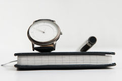 Watch pen and notebook Royalty Free Stock Photos