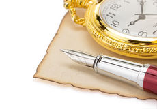 Watch and pen at parchment Stock Images