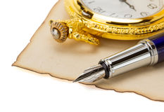 Watch and pen at parchment Stock Photo