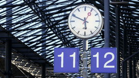 Watch on a platform of the railway station in Helsinki, Finland. Time Lapse. HELSINKI, FINLAND - JUNE 16, 2016: Watch on a platform of the railway station in stock video