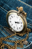 Watch in pocket of jeans Royalty Free Stock Photo