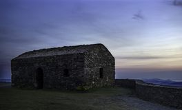 Post lookout, S. XVI. Watch post of the XVI century located on the cliffs of the north coast of Galicia, photo taken at dusk when it was already dark Royalty Free Stock Images