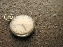 Watch in Rain. Pocket watch in the rain Royalty Free Stock Images