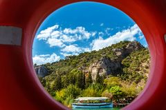 Watch through the red lifeline on the Lycian tombs and boat from. The boat on Lake Koycegiz Royalty Free Stock Photos