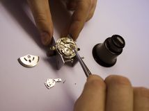 Watch Repair. Inside of a watch. Repair. Focus on watch parts Royalty Free Stock Images