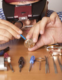 Watchmaker. Watch repair craftsman repairing watch. Focus on face watchmaker Stock Photography