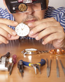 Watchmaker. Watch repair craftsman repairing watch. Focus on watch Royalty Free Stock Photos
