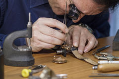 Watch repair. A proffesional worker repairing watches Royalty Free Stock Image