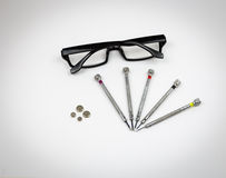 Watch Repair Screwdrivers Glasses and Batteries Royalty Free Stock Photo