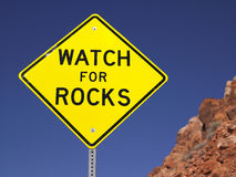 Watch For Rocks Sign Next to Highway Royalty Free Stock Photography