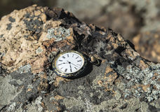 Watch on rocks Stock Photos
