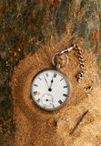 Watch sand and slate. Antique pocket watch on sand and slate Royalty Free Stock Photo