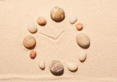 Watch from sea stones on sand. Summer beach background Stock Photos