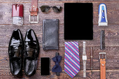 Watch, shoes and gadgets. Bow tie, wallet and cologne. Good look by few steps Stock Image