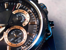 Watch. Small chrome and black wrist watch royalty free stock images