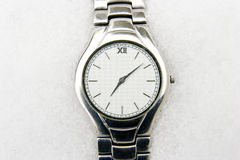 Watch in snow background. Wrist watch in snow background,winter Stock Photos