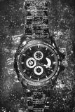 Watch in soda (black and white) royalty free stock photography