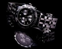Watch - Sports Chronograph. Watch shot in Studio with background as black perspex acrylic Stock Photos