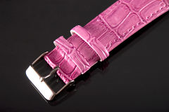 Watch strap. Closeup of watch strap on gray background royalty free stock photo