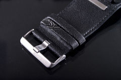 Watch strap. Closeup of leather watch strap on black background stock photos
