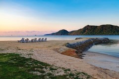 Watch the sunset on the calm Thai beach Royalty Free Stock Image