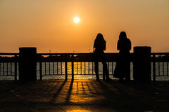 Watch the sunset at the pier. Holiday Royalty Free Stock Photo