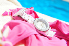 Watch and swimming pool Stock Image