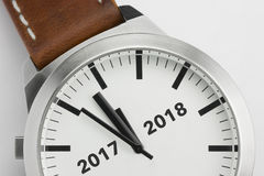 Watch with text 2017 2018. Analog watch with conceptual visualization of the turn of the year 2017 2018 Stock Photography