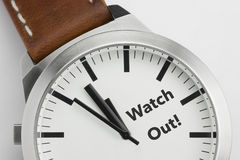 Watch with text Watch Out Royalty Free Stock Image