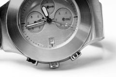 Watch, the time. A macro shot of an silver watch with an motion blur effect on the second hand Royalty Free Stock Photos