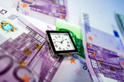 Watch on top of Euro bills Stock Photography
