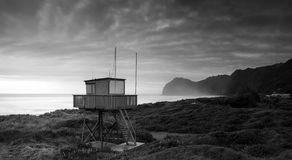 Watch Tower. The lifesaver's watch tower at north piha at dusk just before a storm front moves in royalty free stock photos