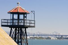 Watch Tower. On Alcatraz overlooking the bay bridge royalty free stock images