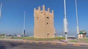 Watch tower of Ajman timelapse hyperlapse. United Arab Emirates. Watch tower of Ajman timelapse hyperlapse with blue sky and traffic. United Arab Emirates royalty free stock photos