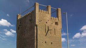 Watch tower of Ajman timelapse. United Arab Emirates. Watch tower of Ajman timelapse with blue cloudy sky. United Arab Emirates stock images