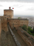 Watch Tower - Alhambra. View of the Watch Tower in Arms Square of Alcazaba, with flags unfurled, overlooking the city of Granada. The Watch Tower bell served as Royalty Free Stock Photo