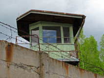 Watch tower behind concrete wall Royalty Free Stock Images