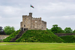 Watch Tower of Cardiff Castle in Cardiff in Wales. Watch Tower with a flag of Cardiff Castle in Cardiff in Wales of the United Kingdom. Cardiff is the capital of royalty free stock photo