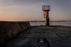 A watch tower at the end of a pier. royalty free stock images